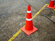 Traffic cone on the asphalt road Royalty Free Stock Image