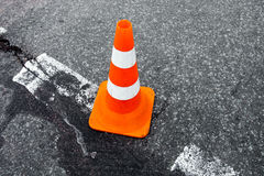 Traffic cone on the asphalt surface. Stock Images