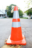 Traffic cone on bitumen pavement. Street stock photography