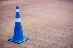 Traffic cone different color. Traffic cone with white and blue stripes on gray road, traffic sign and Mandatory Traffic symbols Royalty Free Stock Image