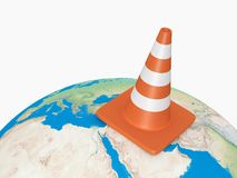 Traffic Cone on Earth. Orange highway traffic cone with white stripes on the world. High resolution on white background Stock Photography