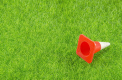 Traffic cone on a grass Stock Photography