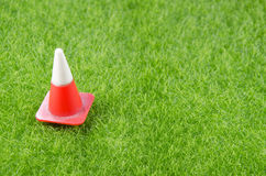 Traffic cone on a grass Royalty Free Stock Image