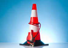 Traffic cone with jump start cable Royalty Free Stock Photos