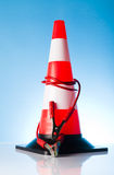 Traffic cone with jump start cable Royalty Free Stock Photo
