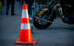 Traffic cone. With a Motorcycle in the background royalty free stock image