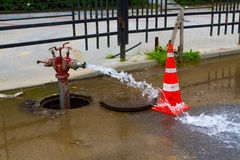 Traffic cone and old red fire hydrant Royalty Free Stock Images