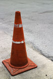 Traffic cone. An orange traffic cone on the road Stock Photo