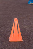 Traffic cone - a orange road cone - orange traffic cone placed in road Royalty Free Stock Images