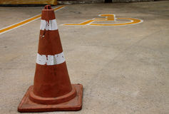 Traffic cone and patient wheelchair sign on parking floor Stock Photography