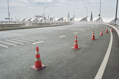 Traffic cone placed on the curving road Stock Image