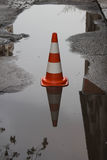 Traffic cone with reflection. Road sign, traffic cone, traffic pylon, road cone, highway cone, safety cone, construction cone Royalty Free Stock Photography