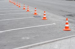 Traffic cone on the road. Closed car parking lot with white mark and traffic cone on street used warning sign on road Royalty Free Stock Images