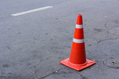 Traffic cone on the road Royalty Free Stock Photos
