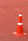 Traffic cone on  the rubber flooring. A Traffic cone on  the rubber flooring Royalty Free Stock Photo
