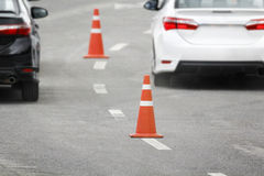 Traffic cone in rush hour Royalty Free Stock Image