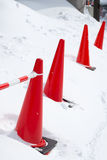 Traffic cone in the snow Royalty Free Stock Photos