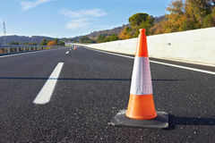 Traffic cone on a speedway Stock Photo