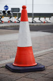 Traffic cone on the street. UK Traffic Cone on the street in front of a roundabout Stock Photo