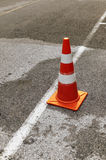 Traffic cone on the street. A traffic cone on the street Stock Photos