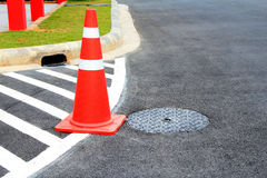 Traffic cone on traffic marking. Stock Photos