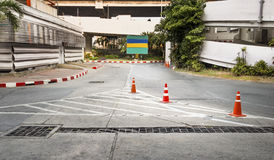 Traffic cone used on concrete pavement Royalty Free Stock Photo
