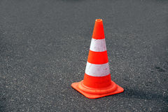 Traffic cone, white and orange  on gray asphalt, copy space. Traffic cone, with white and orange stripes on gray asphalt, copy space Stock Photography