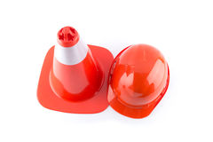 Traffic cone and worker Construction Helmet isolated on white background Stock Photos