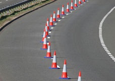 Traffic Cones. A line of traffic cones dividing a highway for maintenance work Stock Photo
