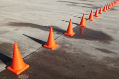 Traffic cones. A row of orange traffic cones set on the road Stock Photo