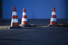 Traffic cones around manhole Stock Photos