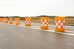 Traffic cones blocking the road. Background red block white sing Royalty Free Stock Images