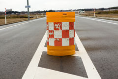 Traffic cones blocking the road. Background red block white sing Stock Photography