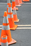Traffic cones blocking street. Group of different traffic cones blocking street Royalty Free Stock Images