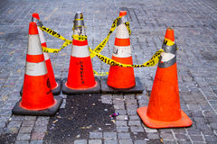 Traffic Cones. With caution tape royalty free stock photo