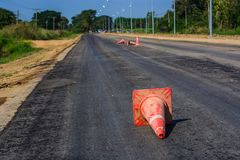 Traffic cones on country road. Traffic cones are used to block traffic areas or restricted areas. Traffic Cone Cones Used in construction or pit areas Royalty Free Stock Images