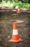 Traffic cones defining route to run through the wood. Outdoor leisure activity stock photo