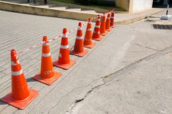 Traffic cones are lined up in the sun. Traffic cones are lined up in the sun at the mall Royalty Free Stock Photography