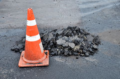 Traffic cones and mounds of asphalt. While road repairs Stock Images