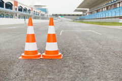 Traffic cones on speedway of stadium Royalty Free Stock Image