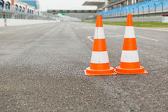 Traffic cones on speedway of stadium Stock Images