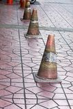 Old traffic cones placed on the sidewalk. Traffic cones were placed on the floor of the old pavement stock photography