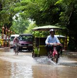 Traffic continues during flood in Phnom Pehh Royalty Free Stock Photo