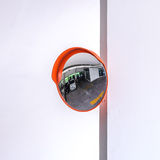 Traffic convex mirror at car park Stock Images