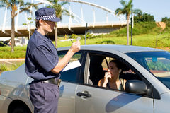 Traffic cop. Checking driver's license Stock Photo