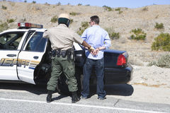 Traffic Cop Arresting Drunken Driver Stock Images