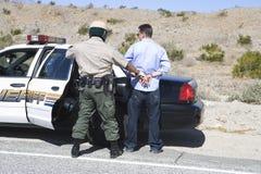 Traffic Cop Arresting Drunken Driver Stock Images