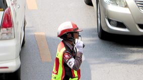 Traffic cop directing traffic on the road. Thai traffic cop directing traffic on the road, Bangkok stock video