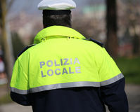 Traffic cop with high visibility uniform and the words local pol Royalty Free Stock Photo