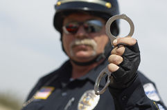 Traffic Cop Holding Handcuffs Stock Image